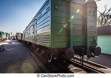 old locomotive stands on the platform of the station.