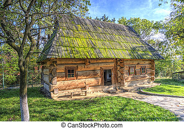 Old log cabin with a bench at the entrance