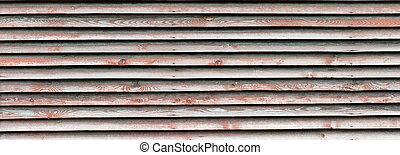 Old long rectangular horizontal wooden wall. Panorama of the old boardwalk.