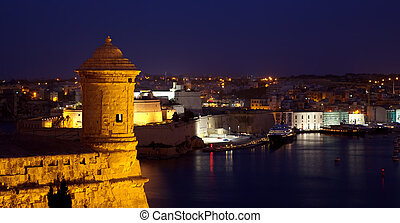 Old lookout tower at Valetta fortress in night. Malta