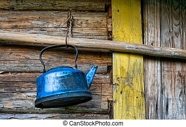 Old lost broken kettle on wooden wall