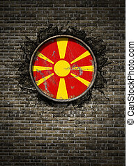 Old Macedonia flag in brick wall
