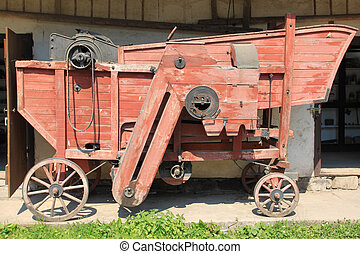 Old machine - Vintage threshing machine (thresher) in an...