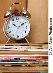 old magazine and old bell clock