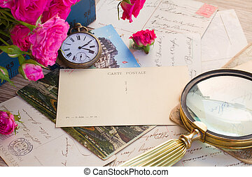 old mail with loupe and antique clock, copy space on empty post card