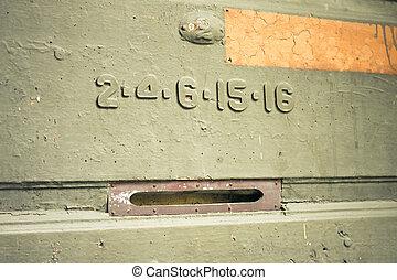 old mail slot in a wooden door