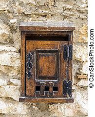 old mailbox at a house wall
