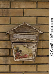 Old mailbox on a brick wall