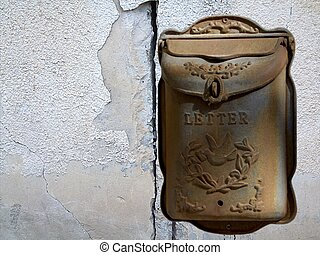 Old mailbox on white wall