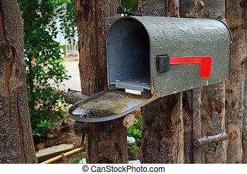 Old mailbox on wood fence outdoor
