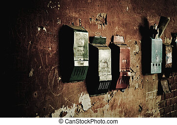 Old mailboxes hanging on the wall