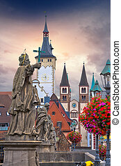 Old Main Bridge over the Main river and scenic towers in the Old Town of Wurzburg vertical view, Bavaria region of Germany