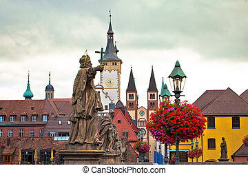 Old Main Bridge over the Main river and scenic towers in the Old Town of Wurzburg view, Bavaria region of Germany