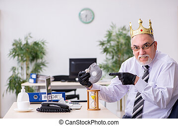 Old male boss employee working during pandemic