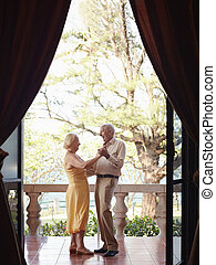 old man and woman dancing outdoor