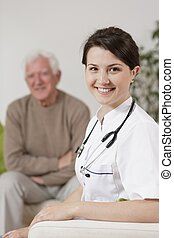 Old man and young nurse - Happy old man and smiling young...
