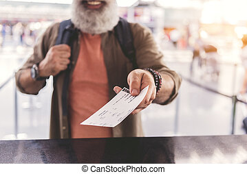 Old man arm holding out card - Focus on close up pensioner...