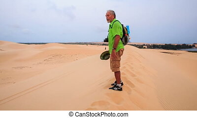 Old Man Arranges Selfie Stick on Crest in White Sand Dunes -...