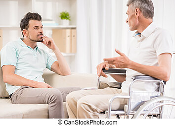 Old man at hospital - Adult man sitting at home and talking ...