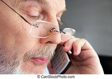 old man at phone