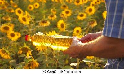 old man close-up sunlight farmer sunflower oil concept...
