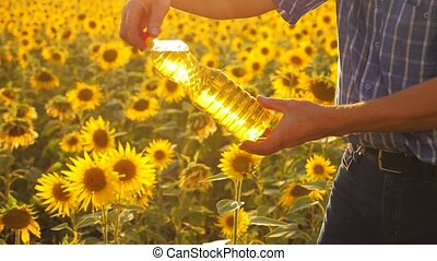 old man close-up sunlight farmer sunflower oil concept...