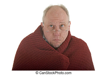 An older man wrapped in a red blanket against the cold on a white background
