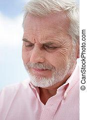 Old man contemplating life