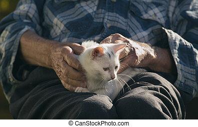 Old man cuddling cat