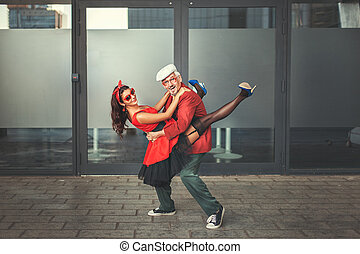 Old man dancing with a young woman.
