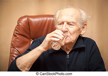 old man drinking water
