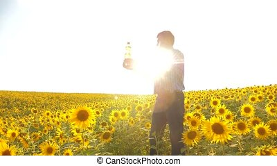 old man farmer sunflower oil concept agriculture. old man...