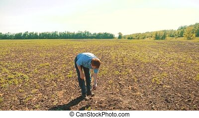old man farmer working peasant hands holding fresh soil....