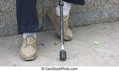 Old man feet and cane. Close up.