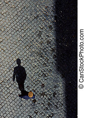 old man from birds view on cobble stone in Lisboa