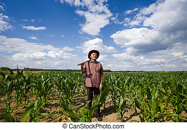 Old man in corn field