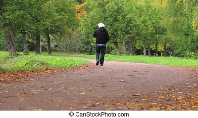 Old man in the autumn Park