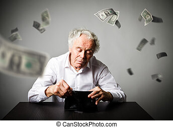 Old man in white and empty wallet. Accounting and taxes. Falling dollars.