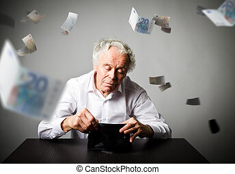 Old man in white and empty wallet. Accounting and taxes.