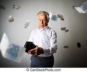 Old man in white and empty wallet. Falling Euro and taxes.