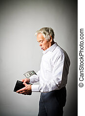 Old man in white and empty wallet. One dollar and taxes.