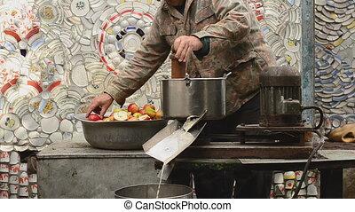 Old Man is Making Apple Juice
