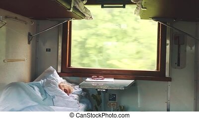 old man is sleeping in the train. concept travel train wagon journey interior. economy wagon railway view from inside indoors. Railway interior passenger transport vacation trip. poor old car lifestyle