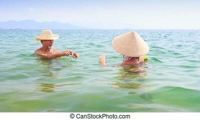 Old Man Mother Little Daughter Splash Water in Azure Sea