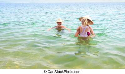 Old Man Mother Little Daughter Swim Play in Azure Sea