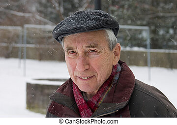 old man on a park at winter