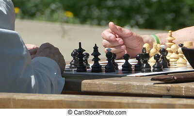 Old Man Playing Chess - Close up of chess players, one an...
