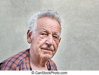 Old man portrait - Senior man portrait against grey wall as ...