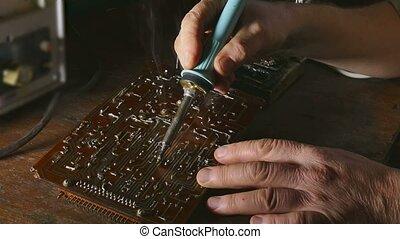 old man retro technician retro radio solder soldering iron