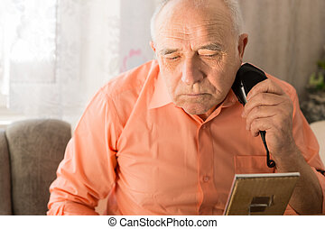 Old Man Shaving Beard with Electric Razor